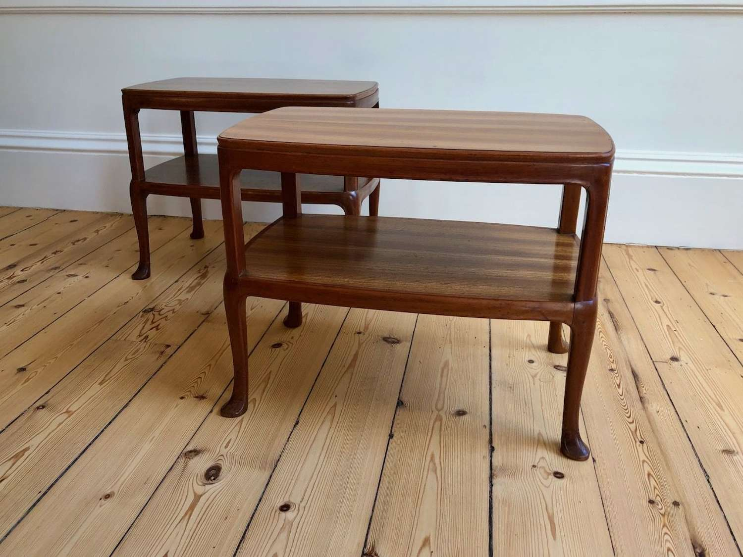 A pair of chic padouk tables