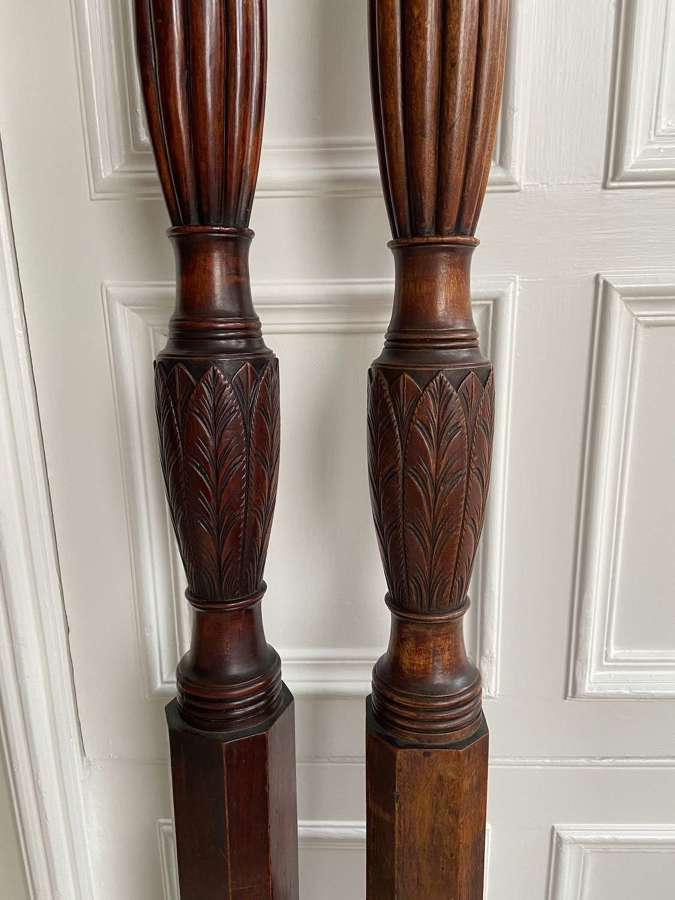 A pair of George III bed posts