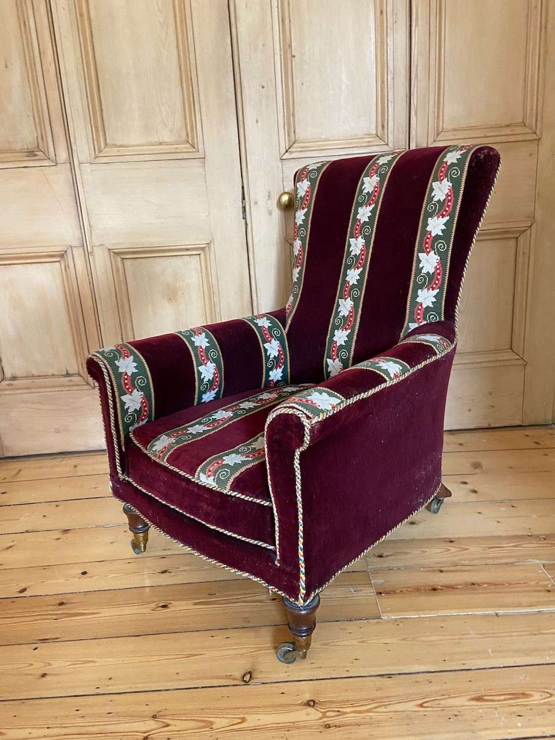 A Victorian Red Velvet and tapestry armchair